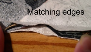 First step is to line up the raw edges of your diagonal strips.- I have shown you a seam I have already sewn